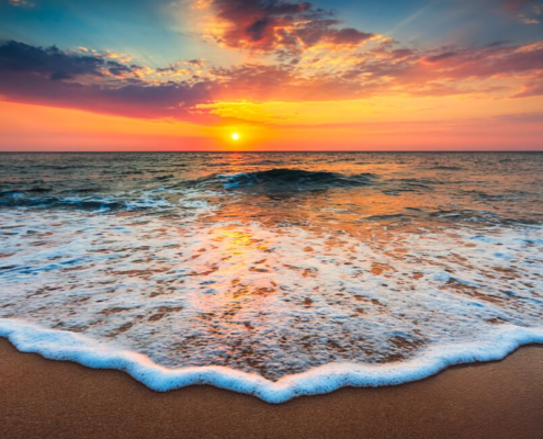 sunset over caribbean water
