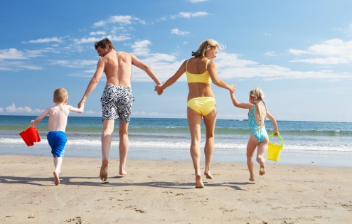 young family palying at beach